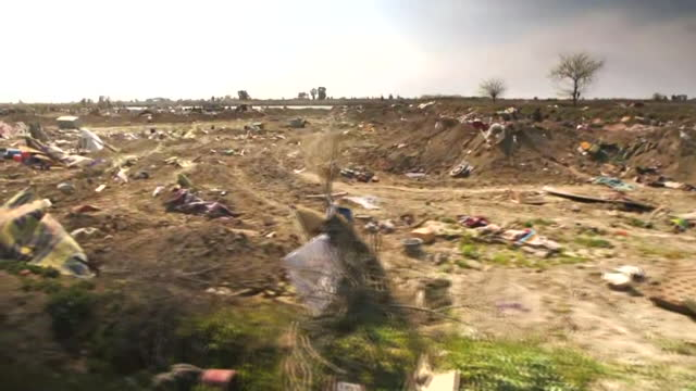 lateral tracking shot of destruction and debris at the ruins of an isis camp in baghouz syria on march 23 2019 - (war or terrorism or election or government or illness or news event or speech or politics or politician or conflict or military or extreme weather or business or economy) and not usa stock videos & royalty-free footage