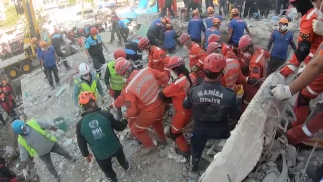 latest footage from turkey's earthquake-hit izmir province shows the search and rescue teams as they try to pull out a victim's dead body out of a... - destruction stock videos & royalty-free footage