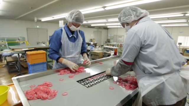 vidéos et rushes de latex condoms sit waiting to be packaged at a sagami rubber industries co factory in atsugi, kanagawa prefecture, japan, on thursday, jan 28 latex... - préservatif