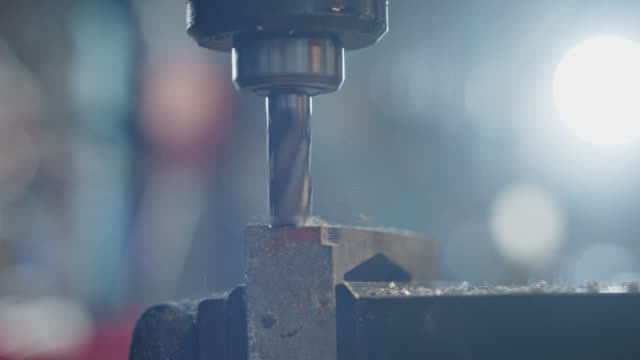 slo mo cu lathe machine burnishes steel in warehouse - metalwork stock videos & royalty-free footage