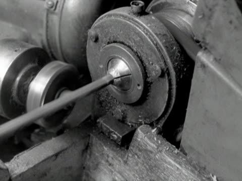 A lathe machine cuts and sharpens pencils in a factory