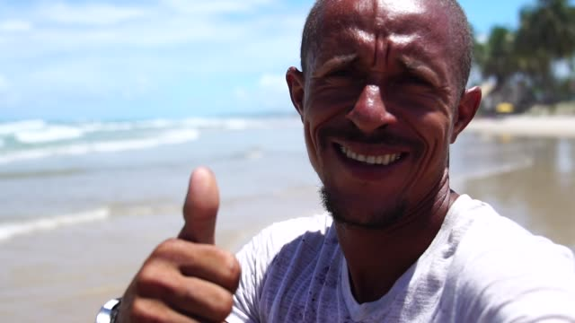 latin adult man taking selfies on the beach - pardo brazilian stock videos & royalty-free footage