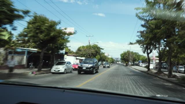 latin america road from a car - マナグア点の映像素材/bロール
