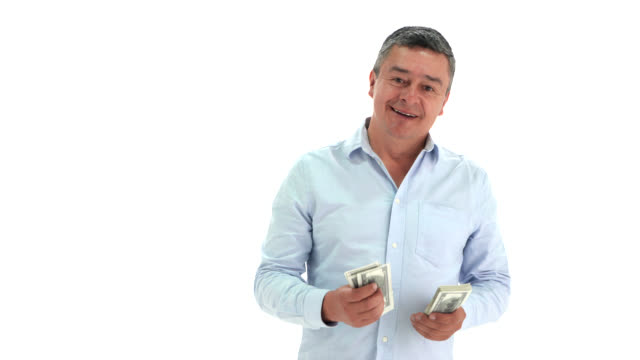 latin american adult man counting a bunch of money and then smiling at camera - us paper currency stock videos & royalty-free footage