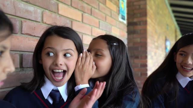 latin american girls at school telling secrets and looking very happy - gossip stock videos & royalty-free footage