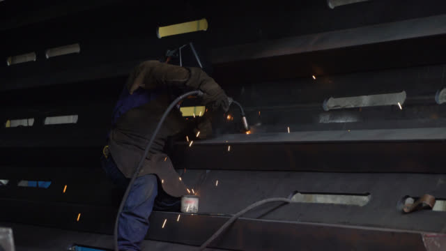 latin american man building a big metallic structure welding a piece - protective workwear stock videos & royalty-free footage
