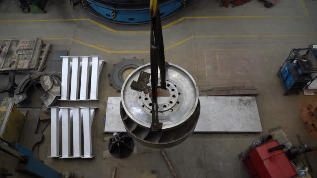 latin american man operating a crane at a metallurgy factory moving a big piece - metallurgy stock videos & royalty-free footage