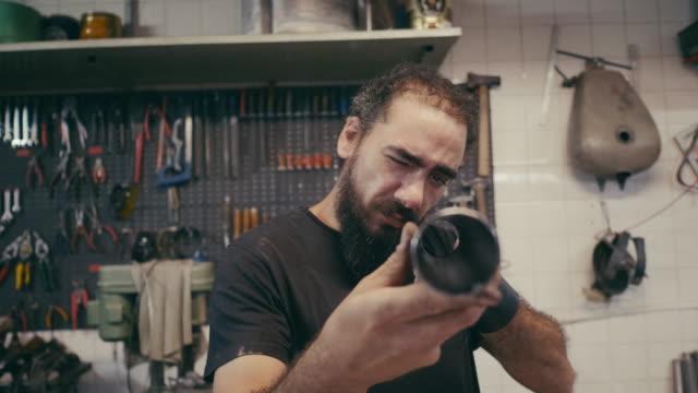 latin american metal worker measuring metal rod - cultura argentina video stock e b–roll