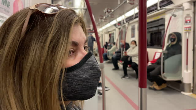 latin american woman riding the toronto transit commission subway wearing a protective face mask on may 10 in toronto, canada. it is the time of the... - profile stock videos & royalty-free footage