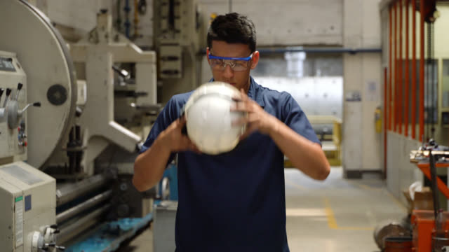 latin american worker at a metallurgy factory wearing protective workwear - metallurgy stock videos & royalty-free footage