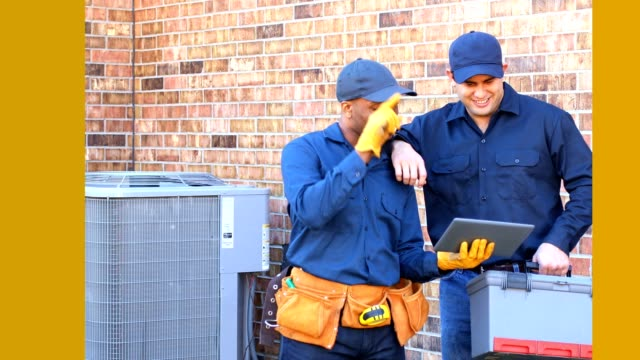 latin and african american blue collar workers fixing ac unit in backyard - electrician stock videos and b-roll footage