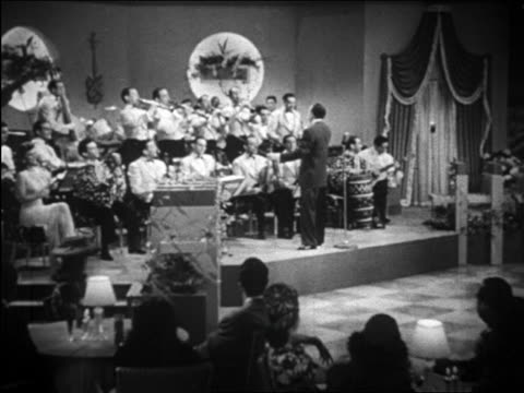 latin big band with band leader directing at front / documentary - conductor stock videos & royalty-free footage