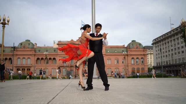 latin couple dancing tango on town square - argentina stock videos & royalty-free footage