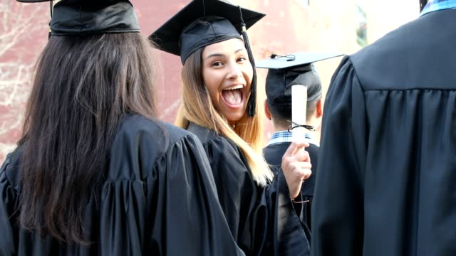 latin descent female college student graduation on campus. - graduation stock videos & royalty-free footage
