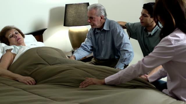 latin family comforts senior woman - ws - omsorg bildbanksvideor och videomaterial från bakom kulisserna