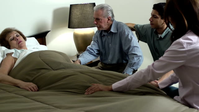 latin family comforts senior woman - ws - husband stock videos & royalty-free footage