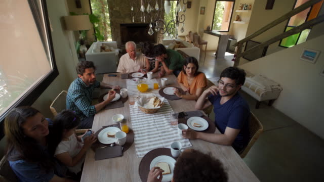 latin family having breakfast together - large group of people stock videos & royalty-free footage