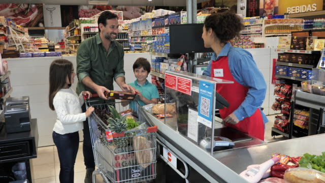 latin family shopping in supermarket - single father in shopping with two kids - shop assistant stock videos & royalty-free footage