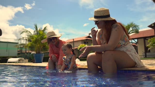 latin family taking a bath in the pool - walking in water stock videos & royalty-free footage