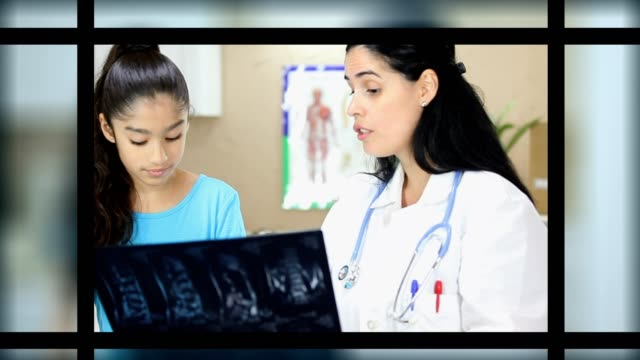 Latin female doctor holding x ray of patient.  She is doing a sports check up on young Latin female patient.