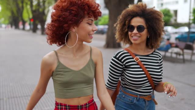 latin friends enjoying beautiful day at city - jewellery stock videos & royalty-free footage