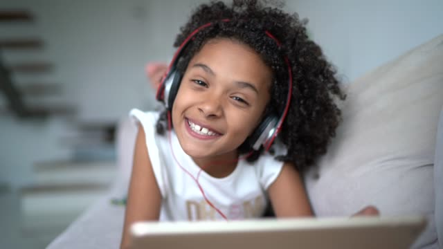 latin girl using digital tablet at home - e learning stock videos & royalty-free footage