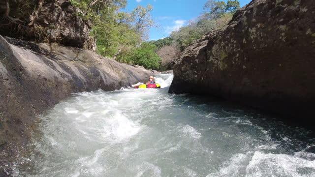 Latin man down on rapids in Costa Rica