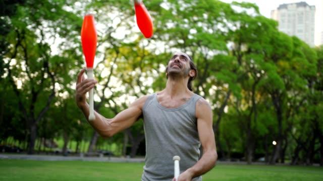 latin modern man performing juggling - juggling stock videos & royalty-free footage