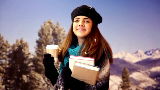 latin student with books, disposable coffee cup in winter snow. - disposable cup stock videos and b-roll footage