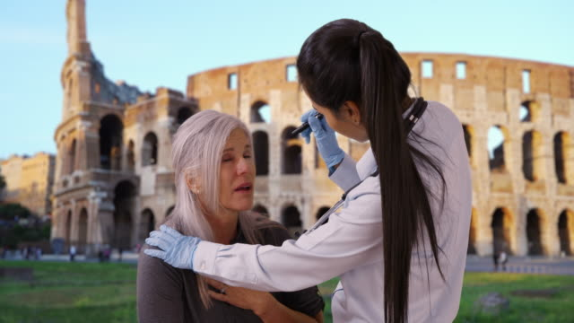 latin woman doctor assists senior woman near coliseum - human heart stock videos & royalty-free footage