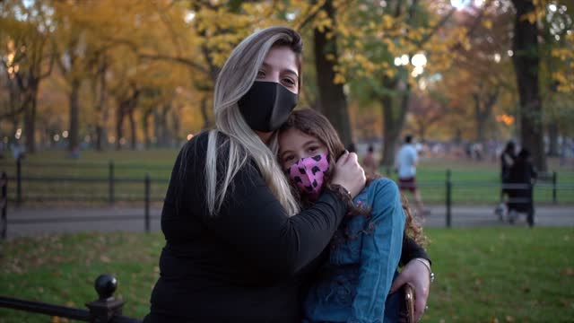 latin woman wearing protective mask in central park new york city - manhattan stock videos & royalty-free footage