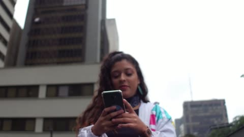 latin young woman using cellphone during rush hour - argentinian ethnicity stock videos & royalty-free footage