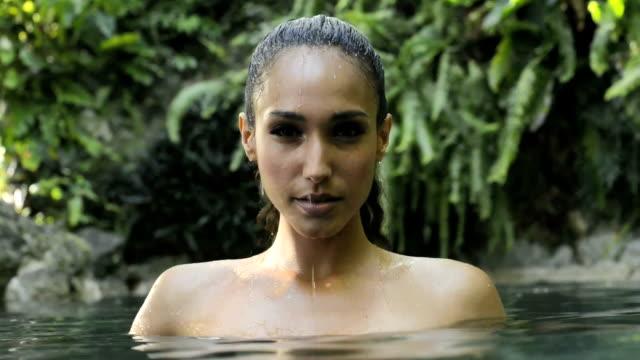 Latina american woman in a natural pool