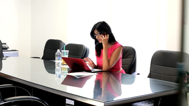 Latina businesswoman woking hard  in conference room