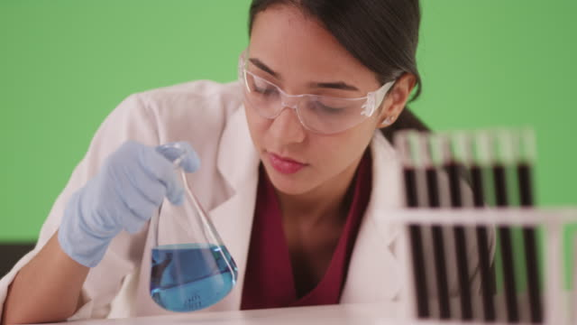 latina scientist or medical researcher with blood samples on greenscreen - medical student stock videos and b-roll footage
