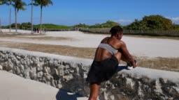 Latina woman jogging in the morning near the beach in USA
