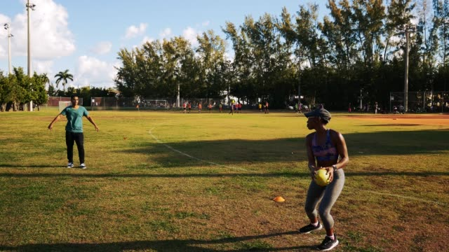 latin/hispanic couple playing american football on sunny summer morning in usa - puerto rican ethnicity stock videos & royalty-free footage