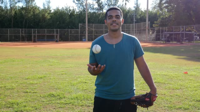 Latino baseball player exercising pitching in USA