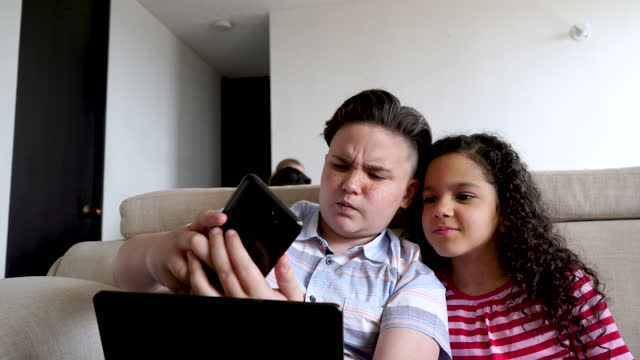 latino brothers do homework while taking cell phone selfies - 12 13 years stock videos & royalty-free footage
