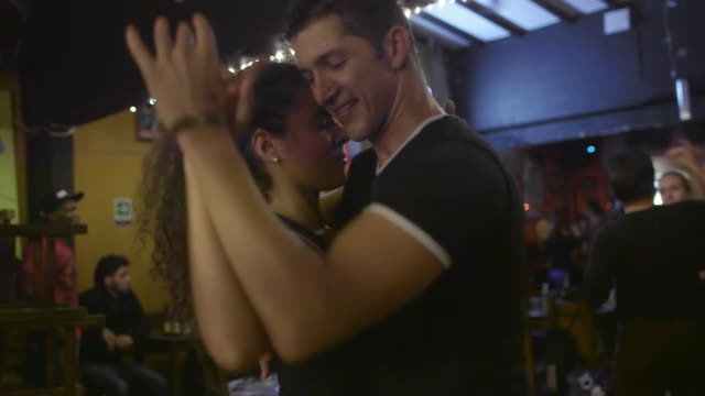 A Latino couple dance in a salsa club / Medellin, Colombia