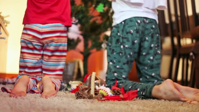 latino lifestyle. sisters decorating the christmas tree. - kneeling stock videos and b-roll footage