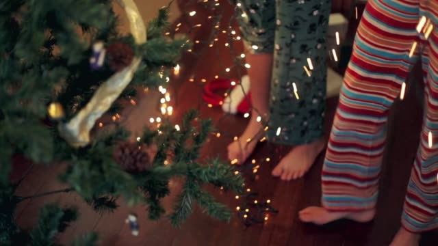 latino lifestyle. sisters untangling christmas lights. - tangled stock videos & royalty-free footage