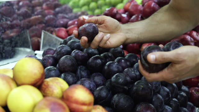 latino man chooses fruits that he wants to buy - freshness stock videos & royalty-free footage