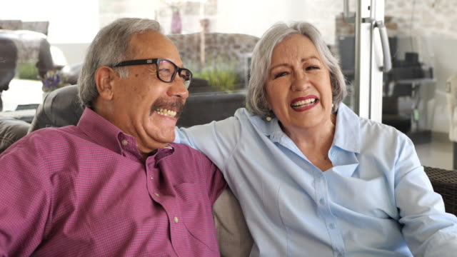 latino senior couple enjoying retirement with loved ones. - mexican culture stock videos & royalty-free footage