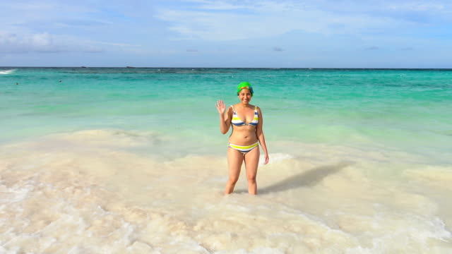 latino woman bathing in punta cana, dominican republic - punta cana stock videos and b-roll footage