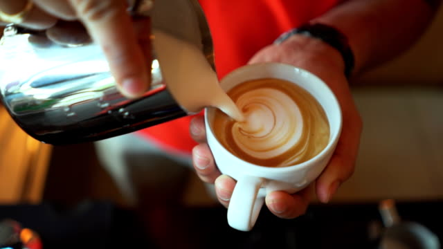 latte art pouring slowmotion - mocha stock videos and b-roll footage