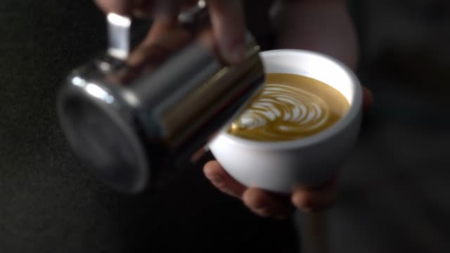 latte in a coffee shop - coffee drink stock videos & royalty-free footage