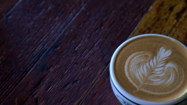 latte in a coffee shop - coffee drink stock videos and b-roll footage