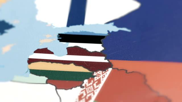Latvia, Estonia with National Flag on World Map