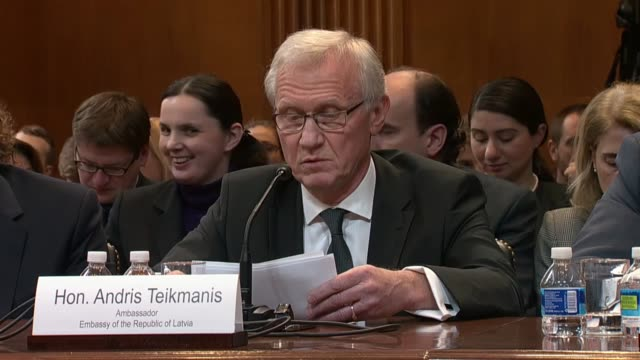 Latvian Ambassador to the United States Andris Teikmanis reads his prepared statement to a subcommittee of the Senate Appropriations Committee...